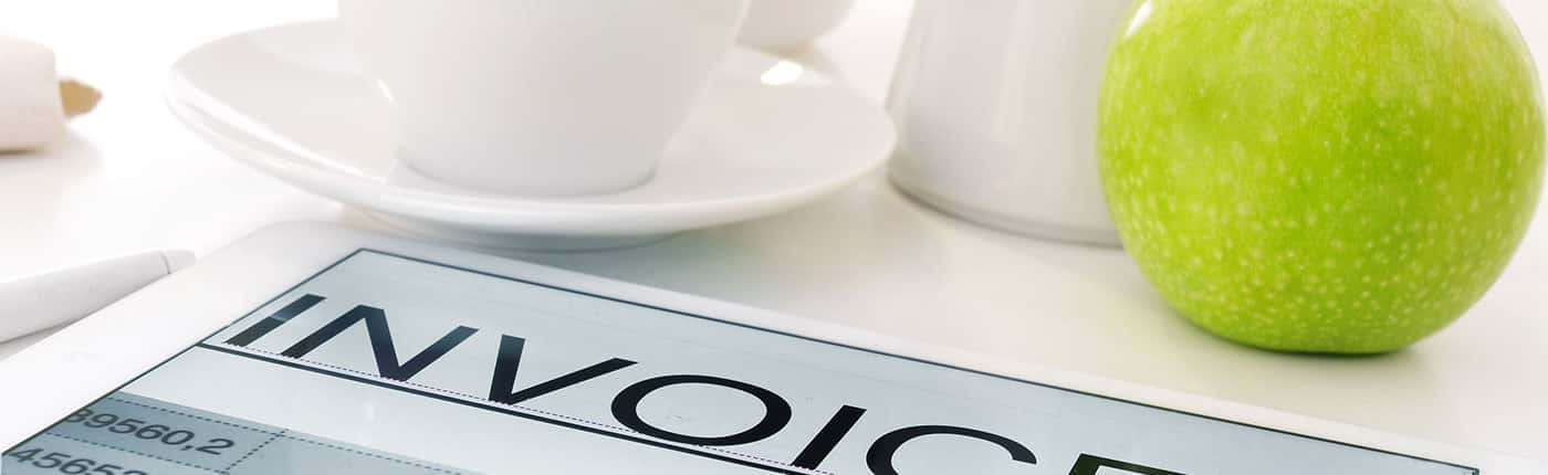 Image of an Invoice on a breakfast table