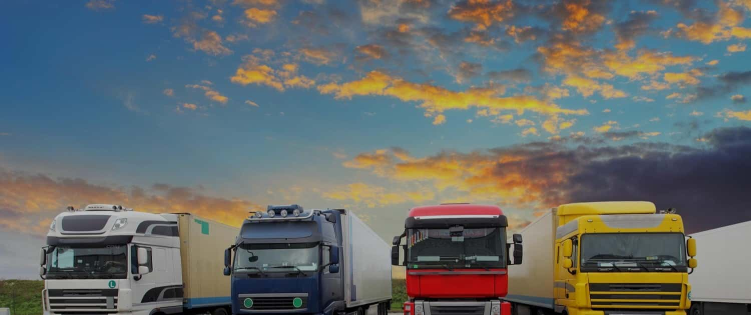 Image of Multiple HGVs on the road - white, blue, red, and yellow
