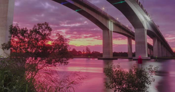 Image of a Bridge over a River at Sunset