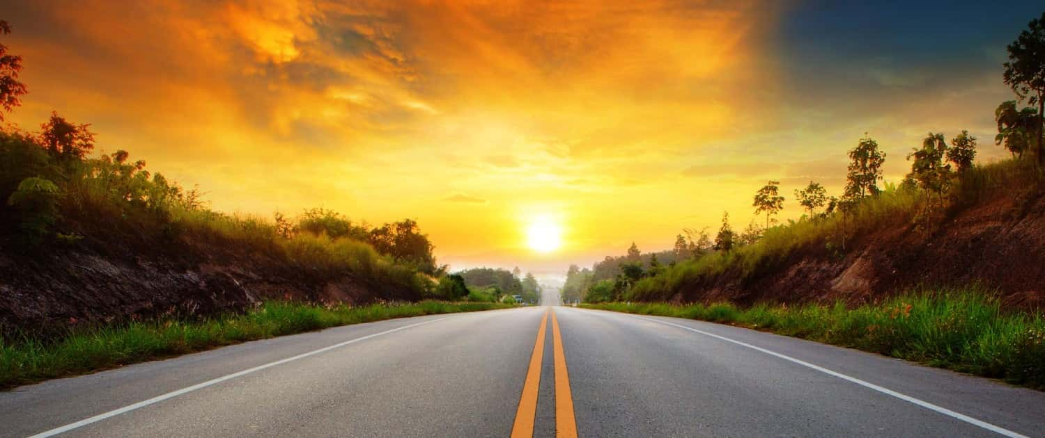 Image of a Sunset over a Country Road