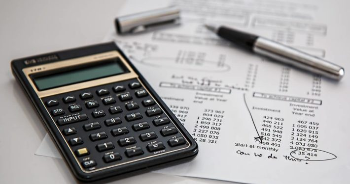 image of calculator and pen