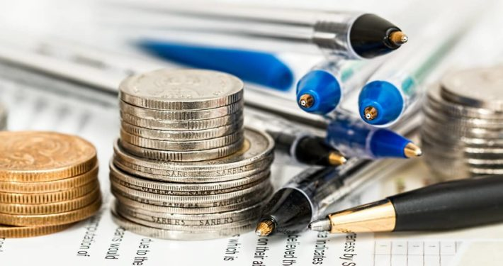 image of money and pens
