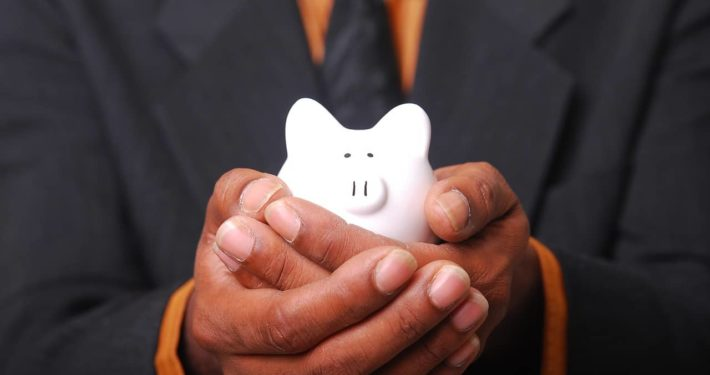 image of someone holding piggie bank for unsecured business loans