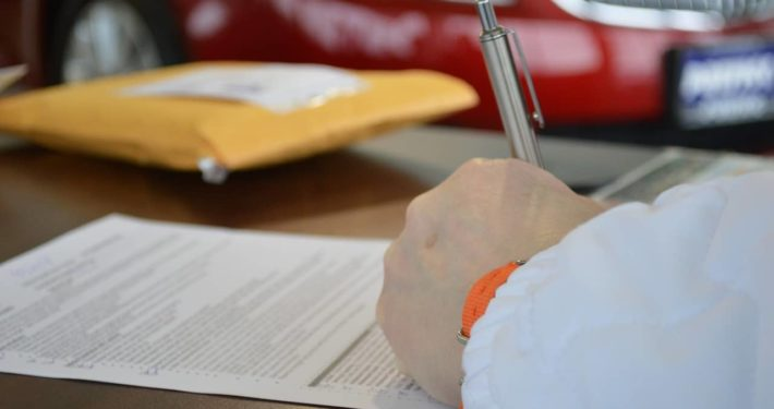 image of person signing commercial loan contact