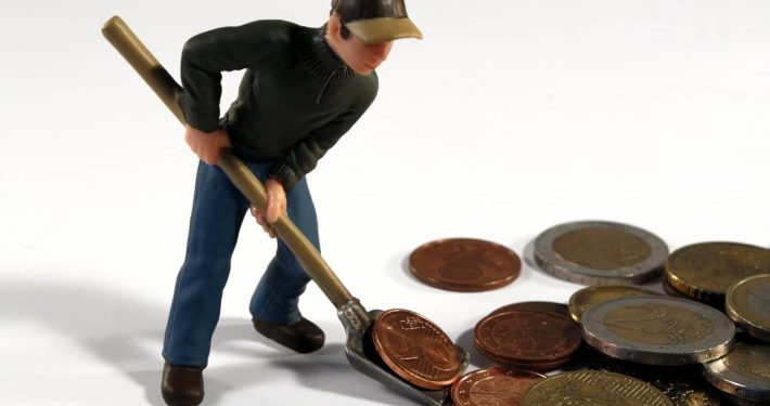 image of a figure scooping money