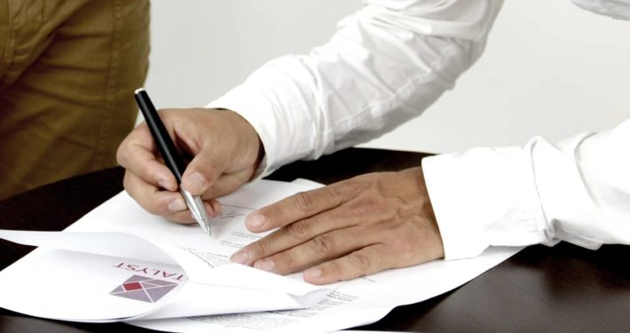 image of someone signing Asset Finance contact