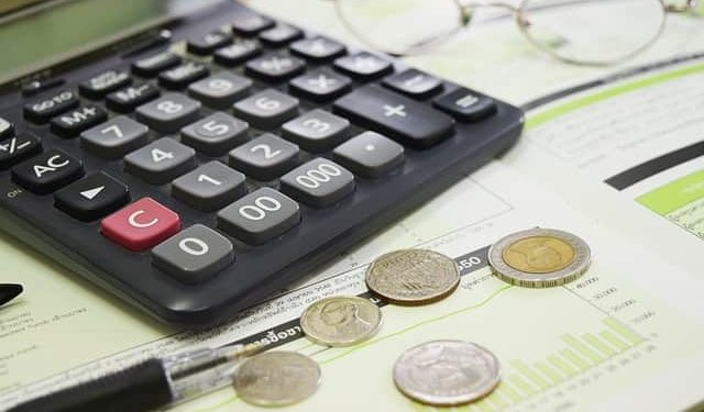 image of calculator with coins and files