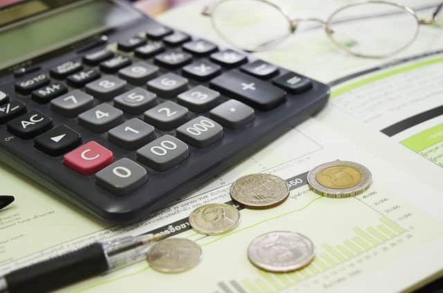 image of calculator with coins and files, Eligible for a Business Loan