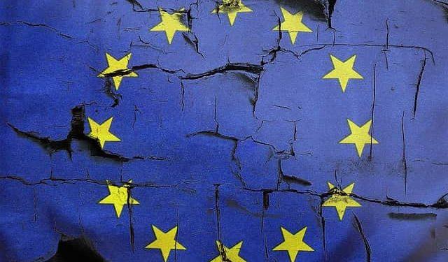 image showing crumbling EU flag