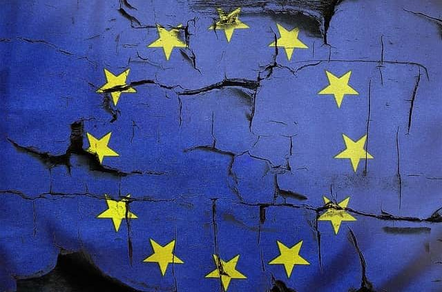image showing crumbling EU flag