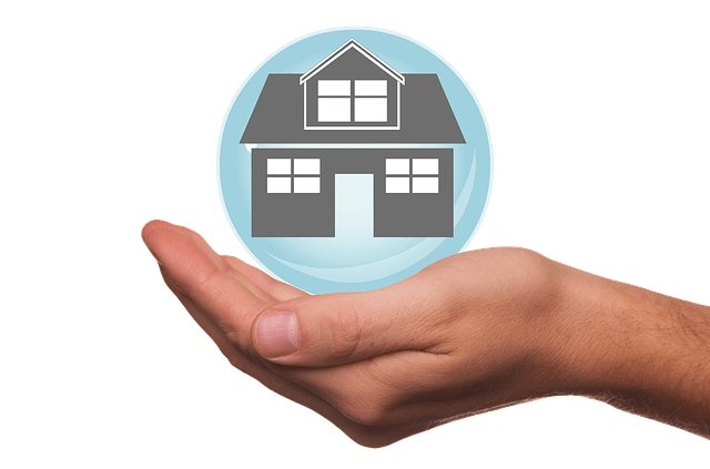 image of hand holding illustration of a house