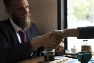 image of man shaking hand in business deal