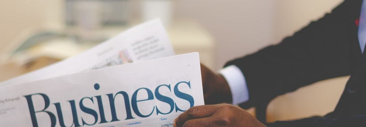 picture of a businessman reading a newspaper